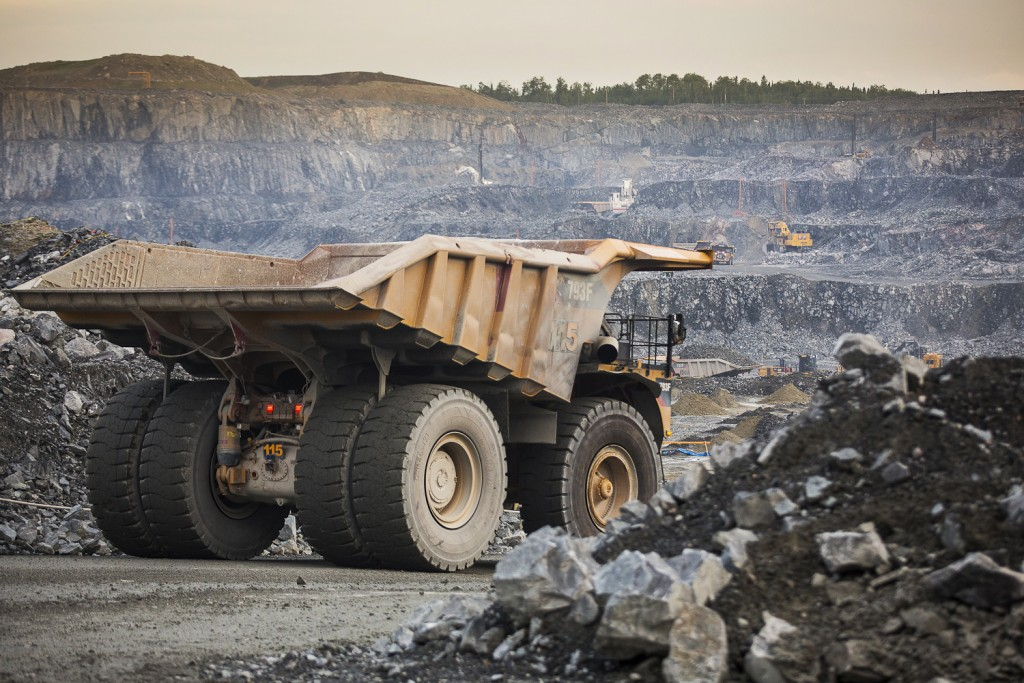 Mining truck with the mine in background